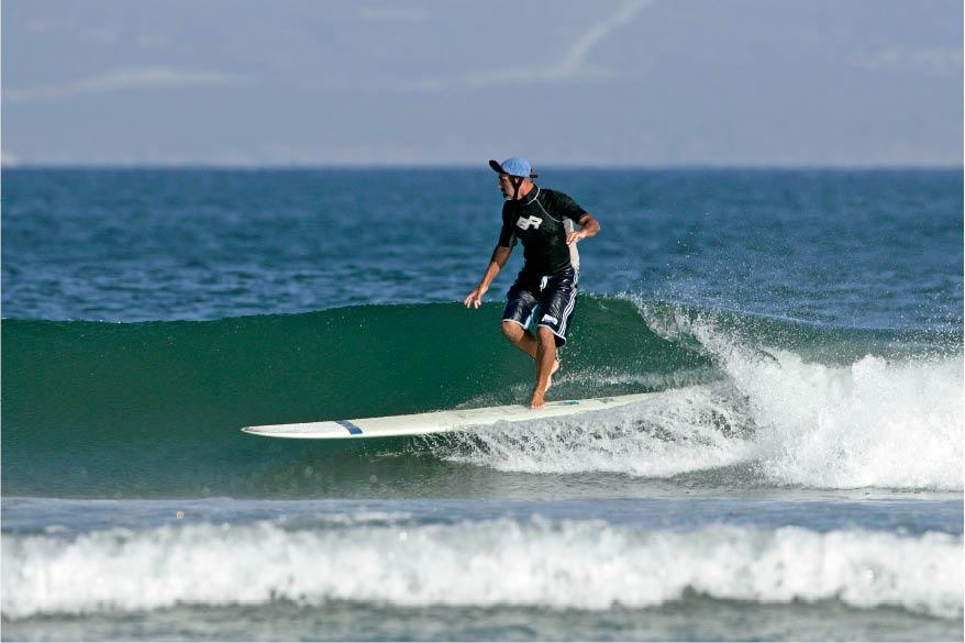 Baja surfer in motion, Baja, Mexico